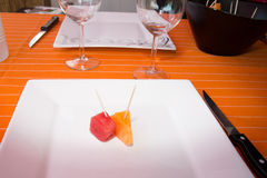 Two pieces of melons and watermelon on the plate Stock Photo