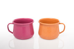 Two pieces of metal mug coating color include path on a white ba Royalty Free Stock Image