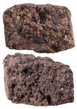 Two pieces of peat (turf) mineral stone isolated Stock Photos
