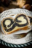 Two pieces of poppie-seed cake on a plate. Selective focus Royalty Free Stock Photo