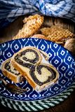 Two pieces of poppie-seed cake on a plate. Selective focus Royalty Free Stock Photos
