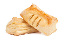 Two pieces of puff pastry Stock Images