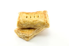 Two pieces of puff pastry. Isolated on the white background Stock Image