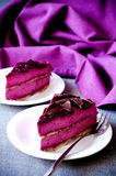 Two pieces of purple cake souffle black currants Royalty Free Stock Images