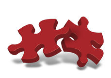Two pieces of puzzle. Two pieces of a puzzle, symbolic of team or work together Stock Images