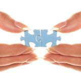 Two pieces of puzzles are connected together Royalty Free Stock Photo