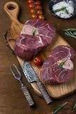 Two pieces of raw meat for ossobuco. On a wooden chopping board Royalty Free Stock Photos