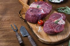 Two pieces of raw meat for ossobuco. On a wooden chopping board Stock Photography