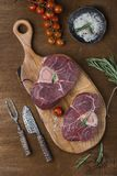 Two pieces of raw meat for ossobuco. On a wooden chopping board Stock Photo