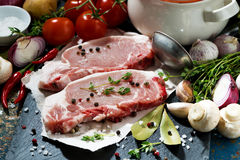 Two pieces of raw pork and ingredients for soup, closeup Royalty Free Stock Photos