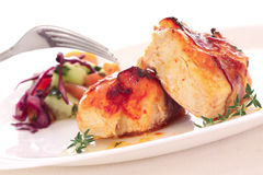 Two pieces of roast chiken with bacon and salad stock photo