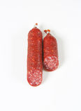Two pieces of salami sausage Stock Images