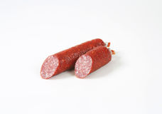 Two pieces of salami sausage Royalty Free Stock Photo