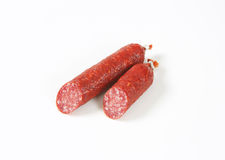 Two pieces of salami sausage Royalty Free Stock Photography
