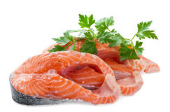 Two pieces of salmon fillet with a sprig of parsley Stock Images
