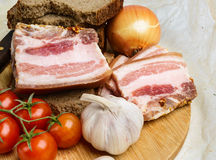 Two pieces of salty bacon with rye bread Stock Images