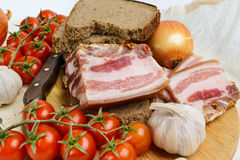 Two pieces of salty bacon with rye bread Stock Photo