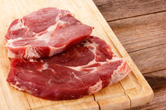 Two pieces of sliced meat on a cutting board Royalty Free Stock Photography