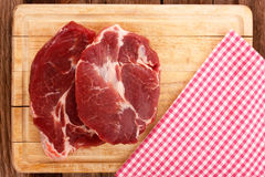 Two pieces of sliced meattwo pieces of sliced meat on a cutting board Stock Image