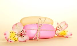 Two pieces of the soap and alstroemeria Stock Photo