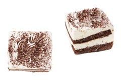 Two pieces of tiramisu cake. Isolated on white background Stock Photography