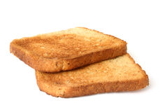 Two pieces of toast. Toasts cast a small shadow Royalty Free Stock Photos