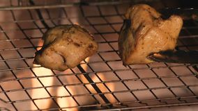 Two pieces of turkey fillet frying on a grill pan. Hd stock video
