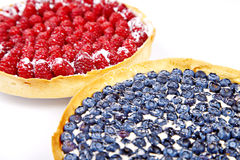Two pies with blueberries and rasberries Stock Photos