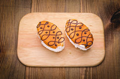 Two pies on a plate on a wooden surface. Couple of cakes on a plate Stock Image