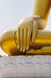 Two Pigeon shady under the hand of Buddha image statue Stock Photo