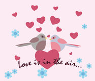 Two pigeons with love hearts Stock Photos