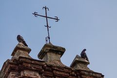 Two pigeons perched on a Chapel at Pigeon Park royalty free stock images