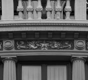 Two pigeons protecting a star. Shot and black and white, detail on the sculpture on the facade of this historic building representing some plants / flowers / Royalty Free Stock Photography