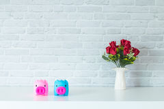 Two piggy bank savings. The two piggy bank On a white table For savings Stock Photos