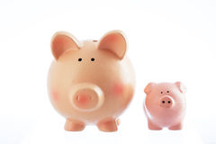Two piggy bank toys isolated on a white background Stock Photography
