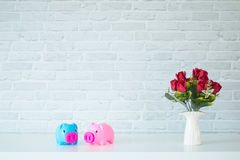 The two piggy bank. On a white table For savings Royalty Free Stock Photos