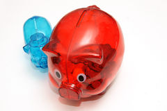 Two piggy banks. Two colored piggy banks on white background Stock Image