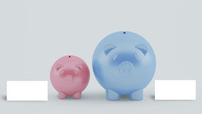 Two piggy banks with blank white card Stock Image
