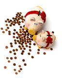 Two piggy banks with coins,. Two happy piggi banks with a lot of coins, on white Royalty Free Stock Images