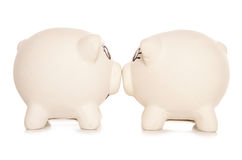 Two piggy banks kissing Stock Photos