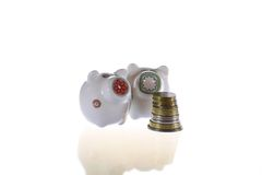 Two piggy-banks in white. Isolated background Stock Photography