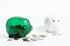 Two piggy banks. On the white background Royalty Free Stock Image