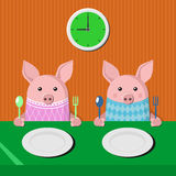 Two piglets at the table Stock Image