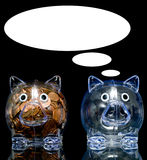 Two Pigs. Two clear acryllic piggy banks one stuffed full of american pennies the other empty, Illustration of the haves and the have nots.  one pig is jealous Stock Image