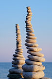Two Pile. Of pebbles in the balance on the seacoast Royalty Free Stock Images