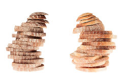 Two pile of slices of black rye bread and white bread with a crispy crust on a white background.  Isolated. Concept art. Stock Image