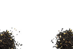 Two pile of  tea leaves on a white background Stock Images