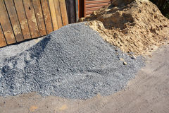 Two piles of gravel and sand at industrial site. Building materials on the construction site. Stock Image