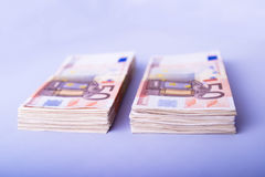 Two Piles Of Fifty Euros Royalty Free Stock Photo