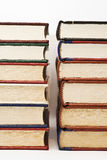 Two piles of old books. Some books isolated on a white background Royalty Free Stock Photo